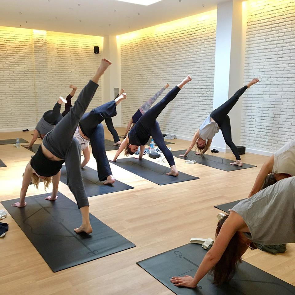 Yoga class in the white room